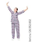 Купить «After sleeping stretched girl in pajamas on a white background in full length», фото № 26552832, снято 2 января 2017 г. (c) Константин Лабунский / Фотобанк Лори