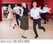 Купить «People practicing twist movements», фото № 26553908, снято 24 мая 2017 г. (c) Яков Филимонов / Фотобанк Лори
