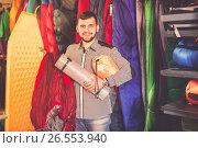 Купить «Guy deciding on touristic equipment», фото № 26553940, снято 8 марта 2017 г. (c) Яков Филимонов / Фотобанк Лори