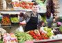 glad male seller showing assortment of grocery shop, фото № 26553976, снято 18 марта 2017 г. (c) Яков Филимонов / Фотобанк Лори