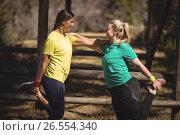 Купить «Happy women exercising during obstacle course», фото № 26554340, снято 16 марта 2017 г. (c) Wavebreak Media / Фотобанк Лори