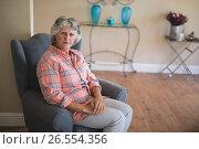 Купить «Portrait of senior woman sitting on couch», фото № 26554356, снято 20 марта 2017 г. (c) Wavebreak Media / Фотобанк Лори