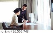 Купить «business team with papers and tablet pc at hotel», видеоролик № 26555748, снято 25 июня 2019 г. (c) Syda Productions / Фотобанк Лори