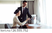 Купить «business team with papers and tablet pc at hotel», видеоролик № 26555752, снято 22 июля 2019 г. (c) Syda Productions / Фотобанк Лори