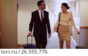 Купить «business team with travel bags at hotel corridor», видеоролик № 26555776, снято 22 июля 2019 г. (c) Syda Productions / Фотобанк Лори