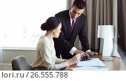 Купить «business team with papers and tablet pc at hotel», видеоролик № 26555788, снято 16 июля 2019 г. (c) Syda Productions / Фотобанк Лори