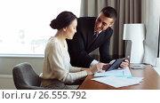 Купить «business team with papers and tablet pc at hotel», видеоролик № 26555792, снято 22 июля 2019 г. (c) Syda Productions / Фотобанк Лори