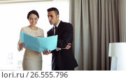 Купить «business team with papers working at hotel room», видеоролик № 26555796, снято 16 июля 2019 г. (c) Syda Productions / Фотобанк Лори