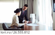 Купить «business team with papers and tablet pc at hotel», видеоролик № 26555812, снято 27 мая 2017 г. (c) Syda Productions / Фотобанк Лори