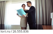 Купить «business team with papers working at hotel room», видеоролик № 26555836, снято 27 мая 2017 г. (c) Syda Productions / Фотобанк Лори