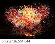 Купить «Beautiful fireworks in a night sky», фото № 26561044, снято 8 августа 2015 г. (c) ElenArt / Фотобанк Лори