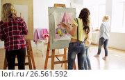 Купить «students with easels painting at art school», видеоролик № 26561592, снято 27 мая 2017 г. (c) Syda Productions / Фотобанк Лори