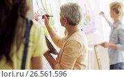 Купить «group of students painting at art school studio», видеоролик № 26561596, снято 27 мая 2017 г. (c) Syda Productions / Фотобанк Лори
