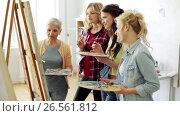 Купить «women with brushes painting at art school», видеоролик № 26561812, снято 27 мая 2017 г. (c) Syda Productions / Фотобанк Лори