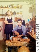 Купить «gay artisans with pottery wheel and various clay vessels», фото № 26561824, снято 19 октября 2018 г. (c) Яков Филимонов / Фотобанк Лори