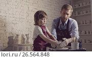 Купить «Family in aprons in pottery», видеоролик № 26564848, снято 18 января 2020 г. (c) Raev Denis / Фотобанк Лори