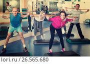 Купить «Group of people exercising in a fitness club», фото № 26565680, снято 23 марта 2019 г. (c) Яков Филимонов / Фотобанк Лори