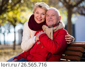 Купить «Mature couple sitting in park», фото № 26565716, снято 18 июля 2018 г. (c) Яков Филимонов / Фотобанк Лори