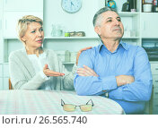 Купить «Mature couple decide family matters and find out relationship», фото № 26565740, снято 20 ноября 2018 г. (c) Яков Филимонов / Фотобанк Лори