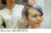 Купить «Styling a client's hair in beauty salon,», видеоролик № 26569872, снято 12 июня 2017 г. (c) Константин Мерцалов / Фотобанк Лори