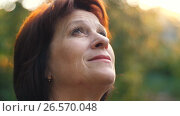 Купить «Aged Woman looks to the sky», видеоролик № 26570048, снято 21 июня 2017 г. (c) Илья Шаматура / Фотобанк Лори