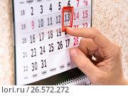 Купить «Hand marking 13th, friday on calendar», фото № 26572272, снято 26 февраля 2016 г. (c) Павел Родимов / Фотобанк Лори