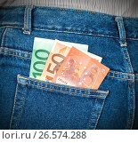 Euro banknotes sticking out of the back jeans pocket. Money for travel and shopping, фото № 26574288, снято 20 июля 2017 г. (c) FotograFF / Фотобанк Лори