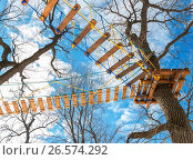 Obstacle course for training against the blue sky in the park, фото № 26574292, снято 21 июля 2017 г. (c) FotograFF / Фотобанк Лори