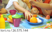 Купить «Child playing with plastic tableware», видеоролик № 26575144, снято 24 июня 2017 г. (c) worker / Фотобанк Лори