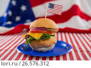Купить «Burger decorated with 4th july theme», фото № 26576312, снято 10 февраля 2017 г. (c) Wavebreak Media / Фотобанк Лори