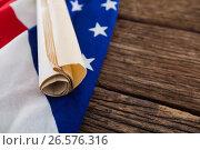 Купить «American flag with rolled-up of constitution document», фото № 26576316, снято 10 февраля 2017 г. (c) Wavebreak Media / Фотобанк Лори