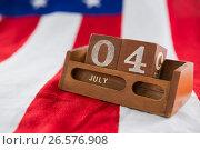 Date blocks on American flag with 4th july theme. Стоковое фото, агентство Wavebreak Media / Фотобанк Лори