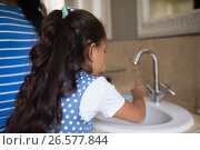 Купить «Girl with mother brushing teeth at bathroom sink», фото № 26577844, снято 15 марта 2017 г. (c) Wavebreak Media / Фотобанк Лори