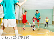 Купить «Children training football in school sports hall», фото № 26579820, снято 16 апреля 2017 г. (c) Сергей Новиков / Фотобанк Лори
