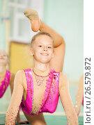 Купить «Portrait of happy girl doing rhythmic gymnastics», фото № 26579872, снято 16 апреля 2017 г. (c) Сергей Новиков / Фотобанк Лори