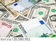Купить «Доллары и евро», фото № 26580952, снято 10 декабря 2011 г. (c) Александр Гаценко / Фотобанк Лори