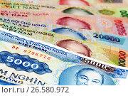 Купить «Набор вьетнамских донгов достоинством от 5000 до 200000, расположенные веером», фото № 26580972, снято 26 мая 2011 г. (c) Александр Гаценко / Фотобанк Лори