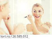 Купить «woman with makeup brush and powder at bathroom», фото № 26585012, снято 13 февраля 2016 г. (c) Syda Productions / Фотобанк Лори