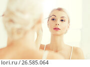 Купить «woman with brush doing eyebrow makeup at bathroom», фото № 26585064, снято 13 февраля 2016 г. (c) Syda Productions / Фотобанк Лори