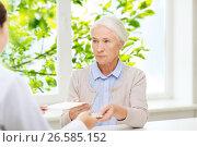 Купить «doctor giving prescription and drug to woman», фото № 26585152, снято 10 июля 2015 г. (c) Syda Productions / Фотобанк Лори