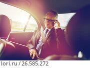 Купить «senior businessman calling on smartphone in car», фото № 26585272, снято 16 июля 2016 г. (c) Syda Productions / Фотобанк Лори