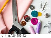 Купить «scissors, sewing tools and cloth», фото № 26585424, снято 29 сентября 2016 г. (c) Syda Productions / Фотобанк Лори
