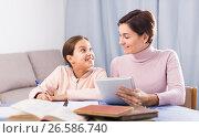 Купить «Mother and daughter doing school homework», фото № 26586740, снято 26 марта 2019 г. (c) Яков Филимонов / Фотобанк Лори
