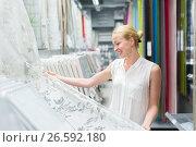 Купить «Woman choosing the right item for her apartment in a modern home furnishings store», фото № 26592180, снято 15 июня 2019 г. (c) Matej Kastelic / Фотобанк Лори