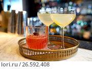 Купить «tray with glasses of cocktails at bar», фото № 26592408, снято 7 февраля 2017 г. (c) Syda Productions / Фотобанк Лори