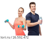 Купить «sportive man and woman with dumbbell and water», фото № 26592472, снято 2 марта 2017 г. (c) Syda Productions / Фотобанк Лори