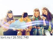 Купить «happy teenage friends with smartphones outdoors», фото № 26592740, снято 21 мая 2016 г. (c) Syda Productions / Фотобанк Лори
