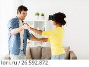 Купить «happy couple with virtual reality headset at home», фото № 26592872, снято 4 февраля 2017 г. (c) Syda Productions / Фотобанк Лори