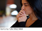 Купить «close up of unhappy woman praying god at funeral», фото № 26592944, снято 20 марта 2017 г. (c) Syda Productions / Фотобанк Лори