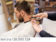 Купить «man and barber hands with trimmer cutting hair», фото № 26593124, снято 6 апреля 2017 г. (c) Syda Productions / Фотобанк Лори
